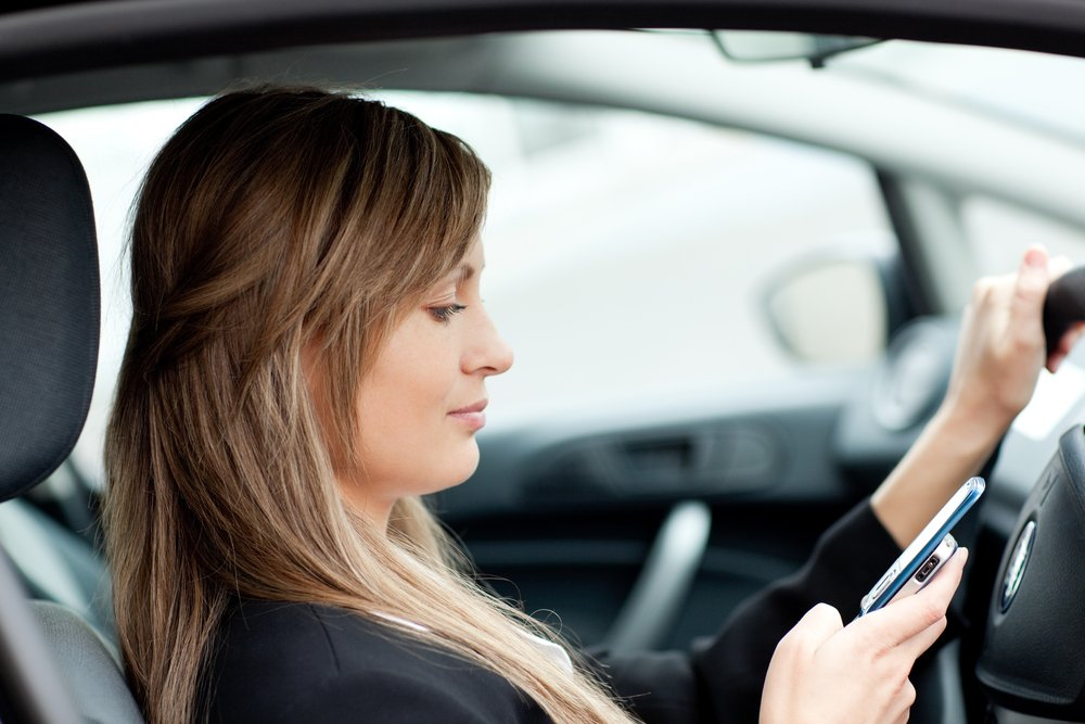 If you have been injured by a texting driver, call 256-547-4988 for a free consultation with our Gadsden distracted driving lawyers right away